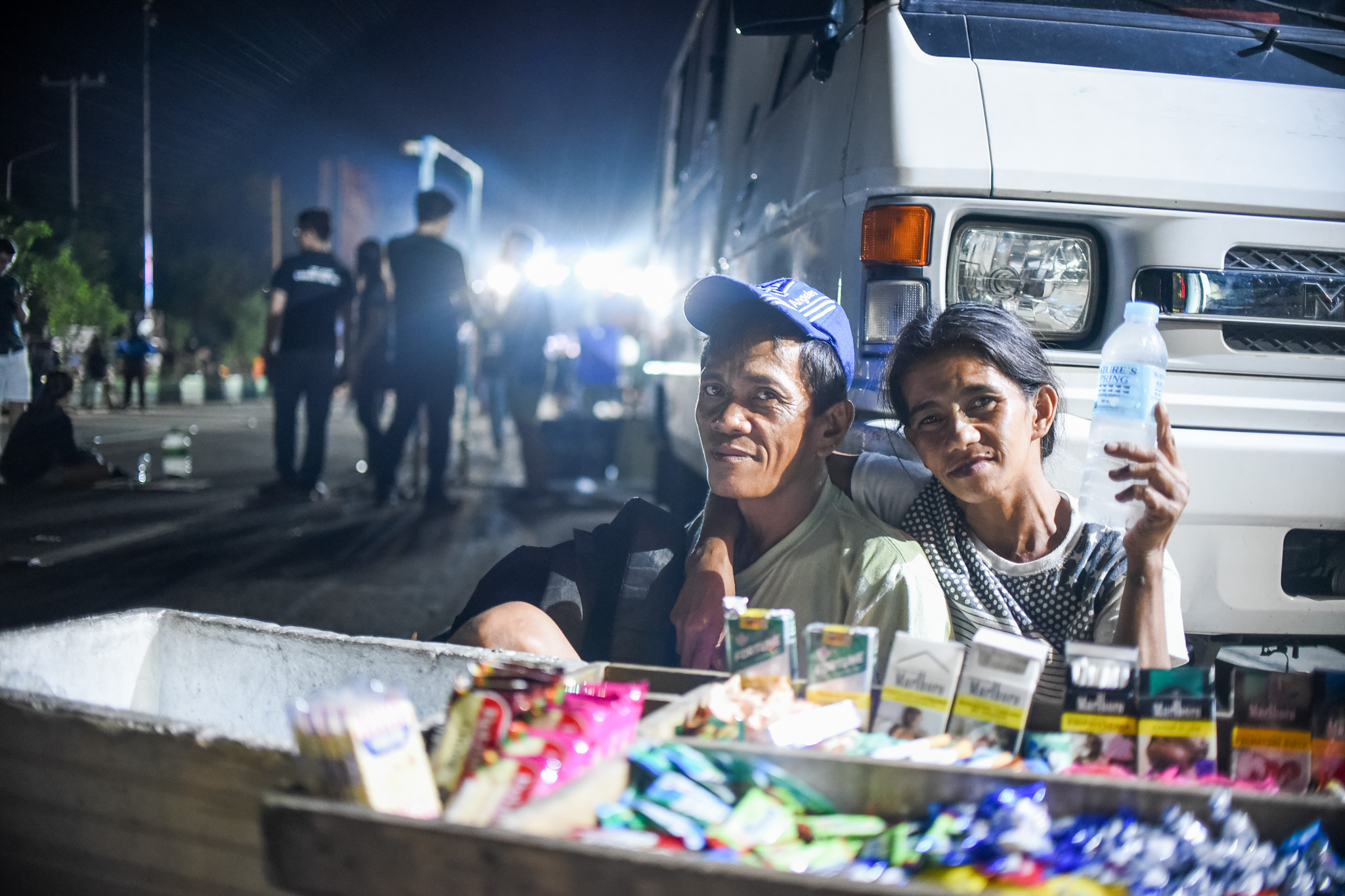 THE ANTONIOS. Danilo and Ging pick a spot beside a parked van at the People Power Monument to sell water, crackers, candies, and cigarettes. Photo by Martin San Diego/Rappler