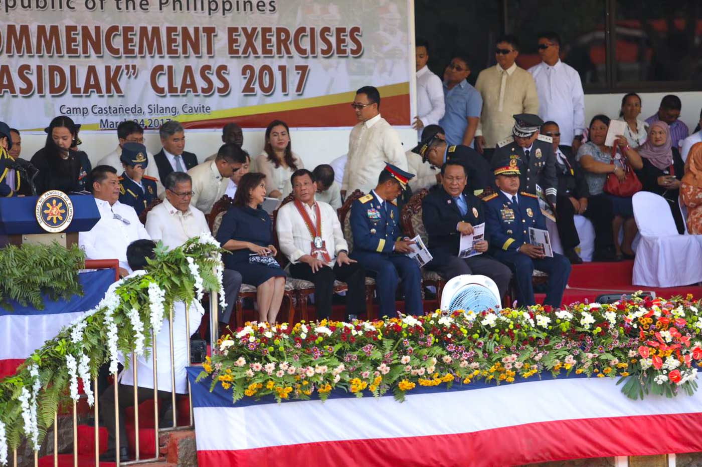 WHAT DID THEY TALK ABOUT? Vice President Leni Robredo and President Rodrigo Duterte chat at the Commencement Exercises of Philippine National Police Academy Class 2017. Photo from Office of the Vice President