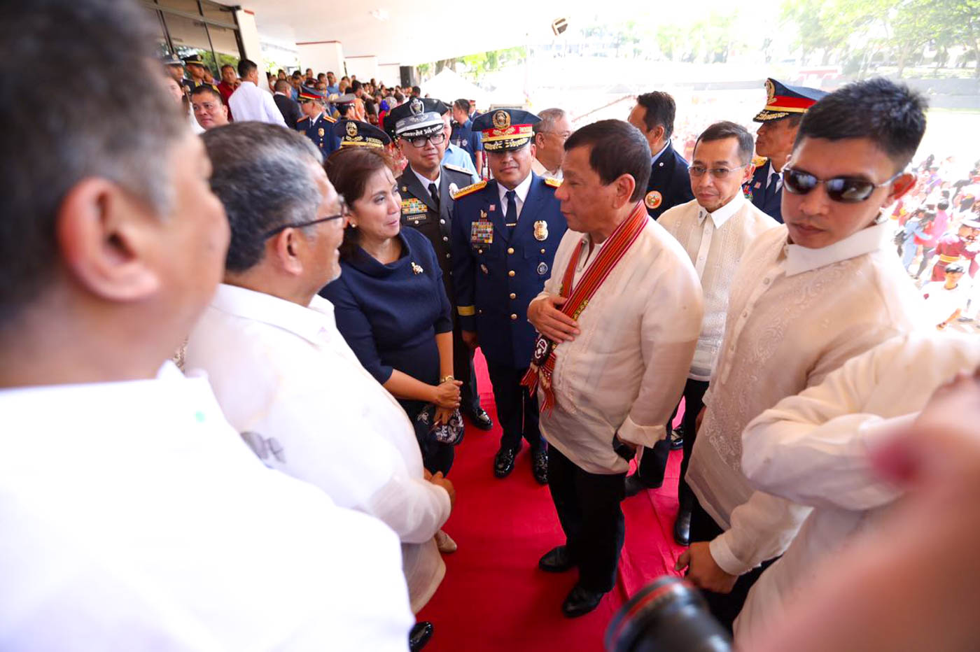 GREETINGS. President Rodrigo Duterte and Vice President Leni Robredo exchange pleasantries at the 38th Commencement Exercises of the Philippine National Police Academy Lcass 2017 in Silang, Cavite, on March 24, 2017. Photo from Office of the Vice President