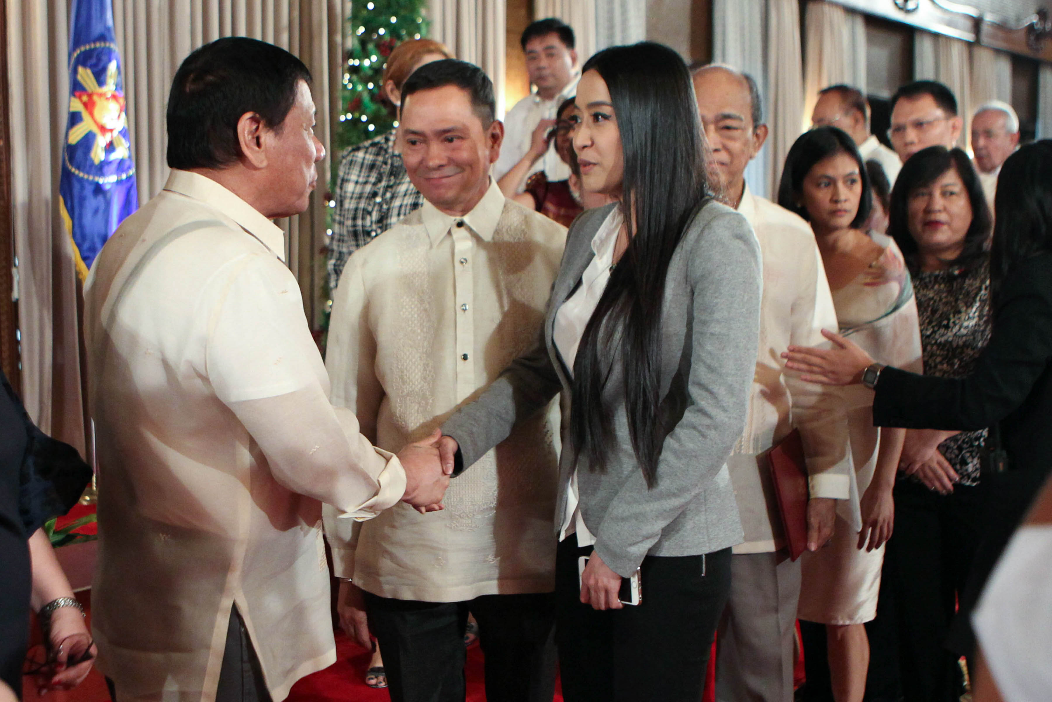 MTRCB BOARD MEMBER. President Rodrigo Duterte congratulates newly-appointed Movie and Television Review and Classification Board (MTRCB) member Mocha Uson during the oath-taking ceremony onu00a0January 9, 2017. Photo by Robinson Niu00f1al/Presidential Photo