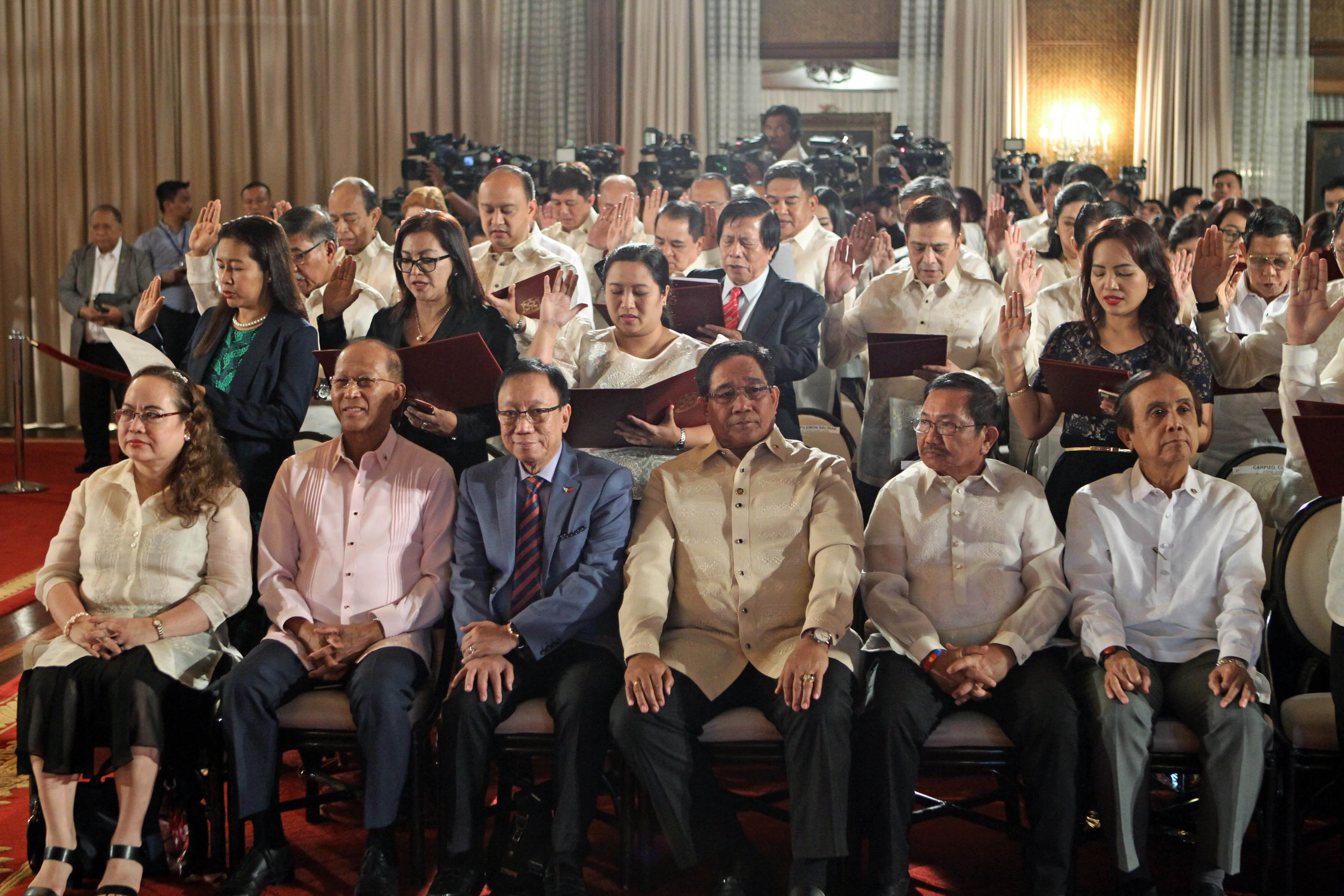 OATH-TAKING. Members of the Duterte Cabinet are seated in the front row as new government appointees are sworn in on January 9, 2017. Photo by Robinson Niu00f1al/Presidential Photo