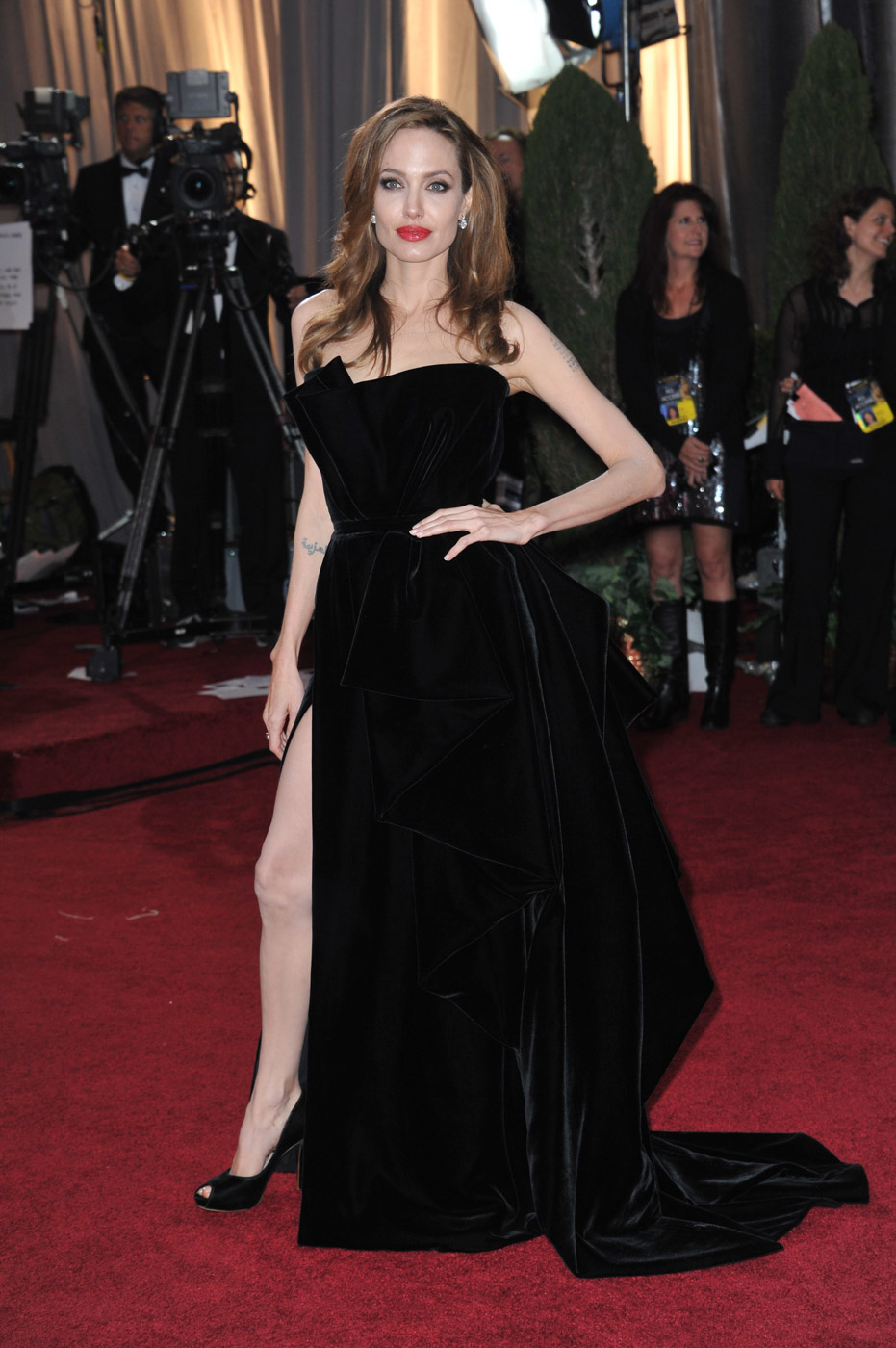 LEG UP. Angelina Jolie goes viral in a velvet Versace dress.
