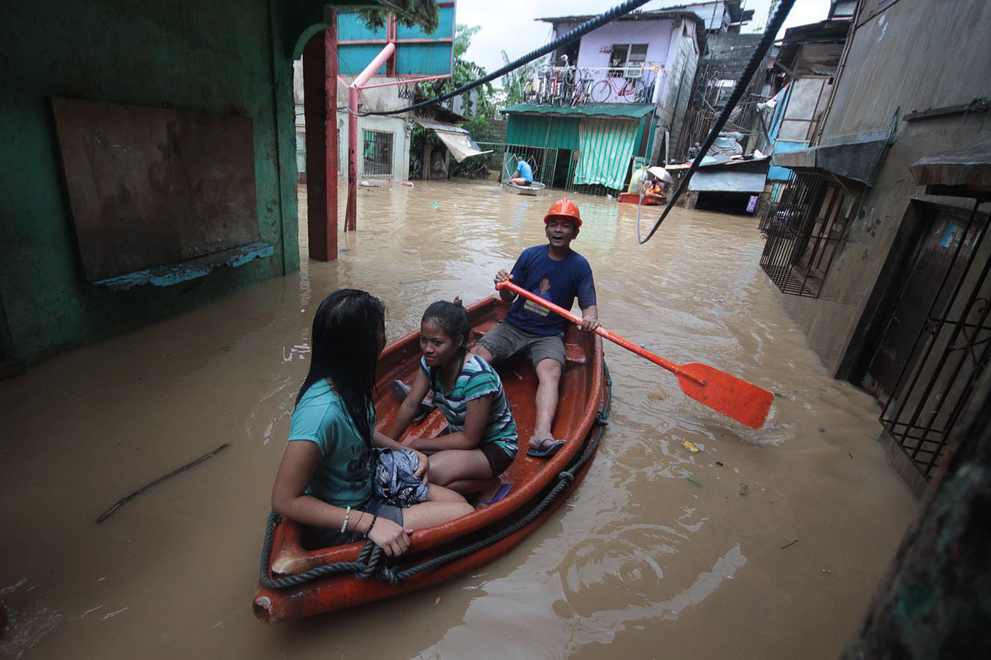 IN RIZAL. Residents of Barangay Banaba in San Mateo on a boat in waist-deep flood as they evacuate from their houses. Photo by Darren Langit/Rappler