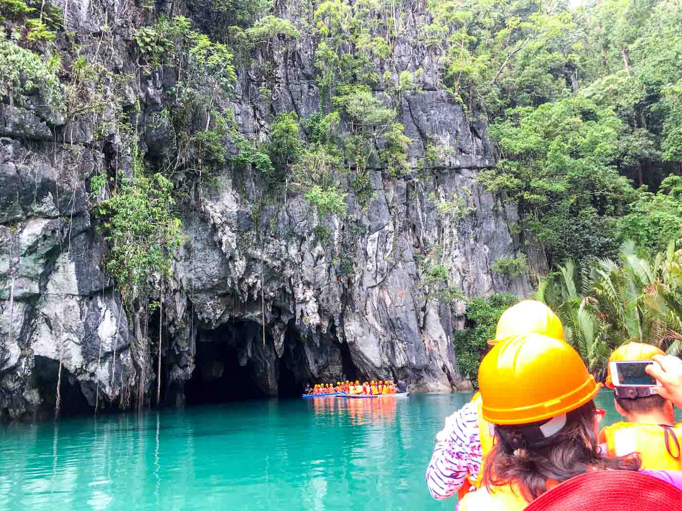FAMOUS DESTINATION. Tourists aboard boats at the entrance of the Puerto Princesa Underground River. File photo by Mara Cepeda/Rappler