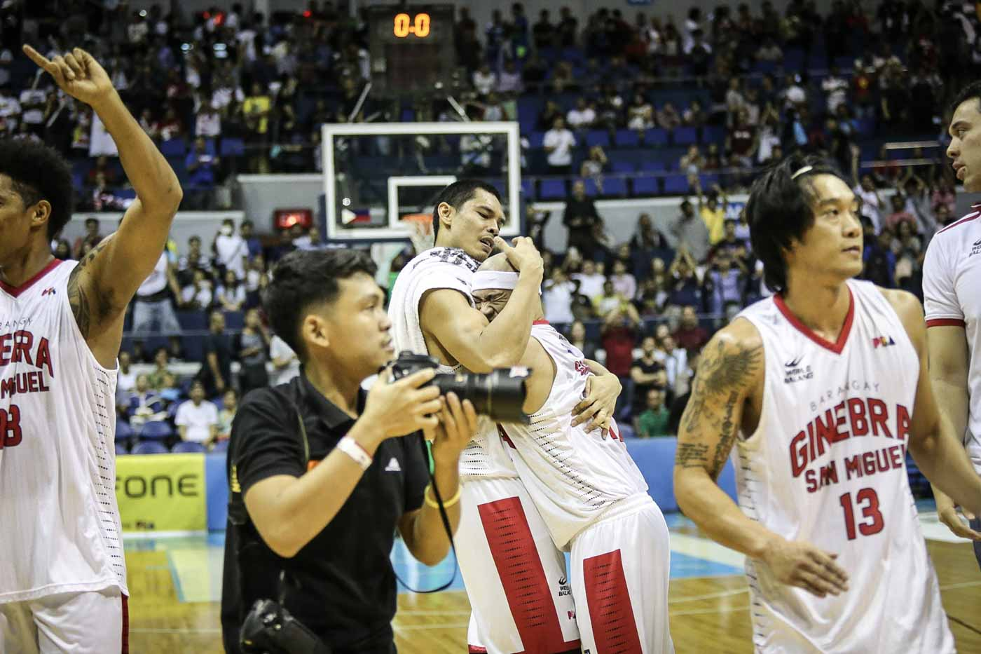 HUG. Japeth Aguilar and Mark Caguioa hug it out. Photo by Josh Albelda/Rappler