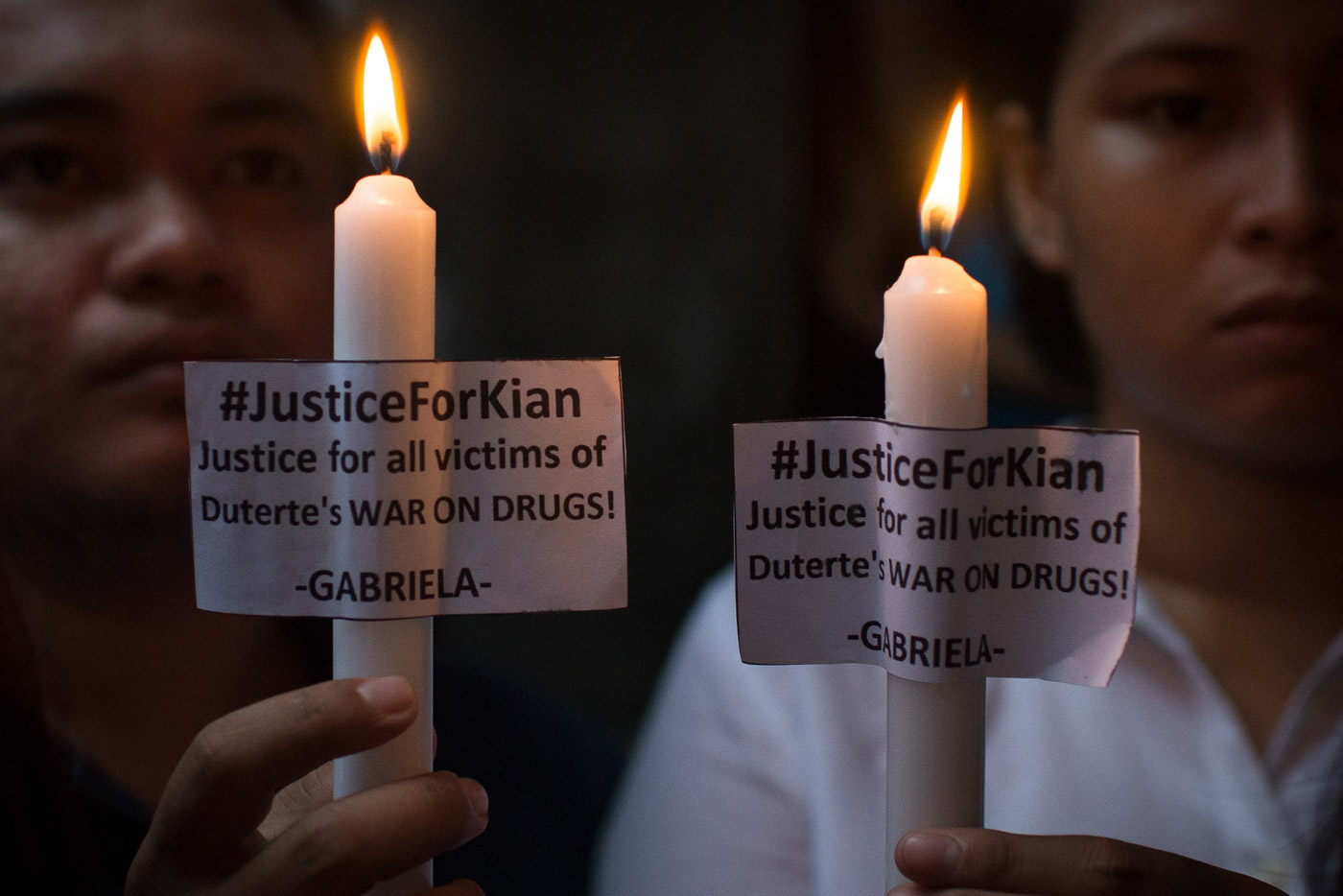 Protesters, neighbors, and friends of Kian Loyd Delos Santos light candles to express their call for justice on the death of the slain kid. Photo by Eloisa Lopez