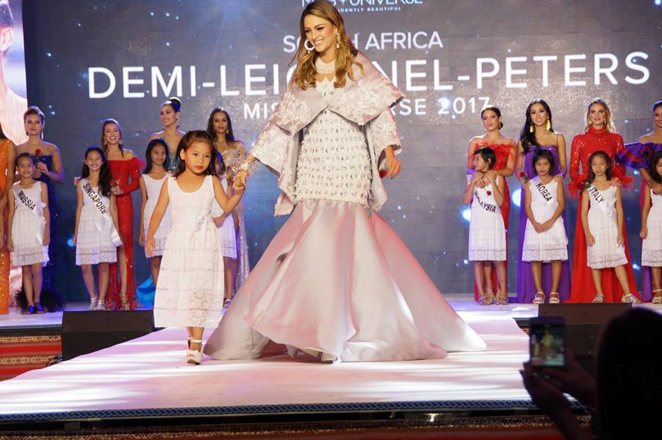 Demi-Leigh Nel-Peters with one of the kids from the Kanlungan sa Er-ma Foundation. This part of the program resembled the Little Sisters segment of the pageant in the '80s and '90s. Photo from the Department of Tourism