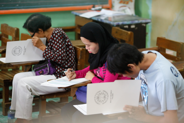 Filipinos participate in a mock election held at public school in Manila, Philippines, on February 13, 2016. Mark R. Cristino/EPA
