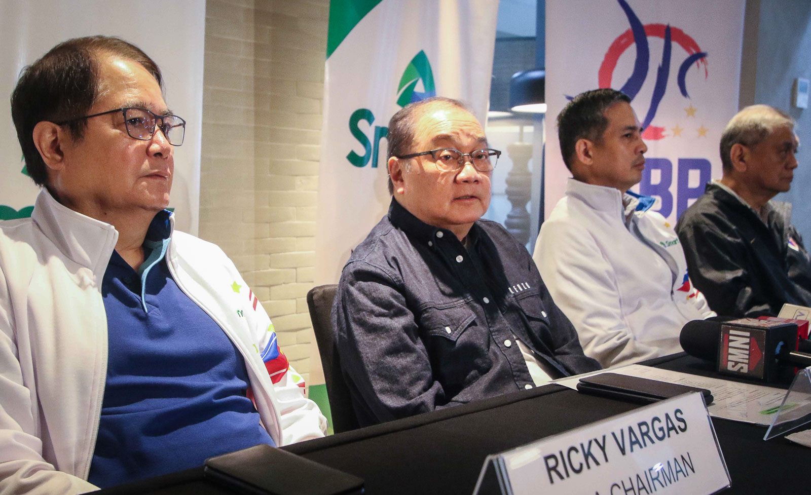 File photo of Filipino tycoon Manny Pangilinan (center, in black) by KD Madrilejos/Rappler