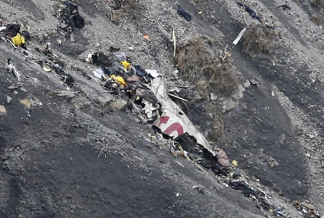 MANGLED. Debris as search and rescue workers are at the crash site of the Germanwings Airbus A320 that crashed in the French Alps, above the town of Seyne-les-Alpes, southeastern France, 25 March 2015. Guillaume Horcajuelo/EPA