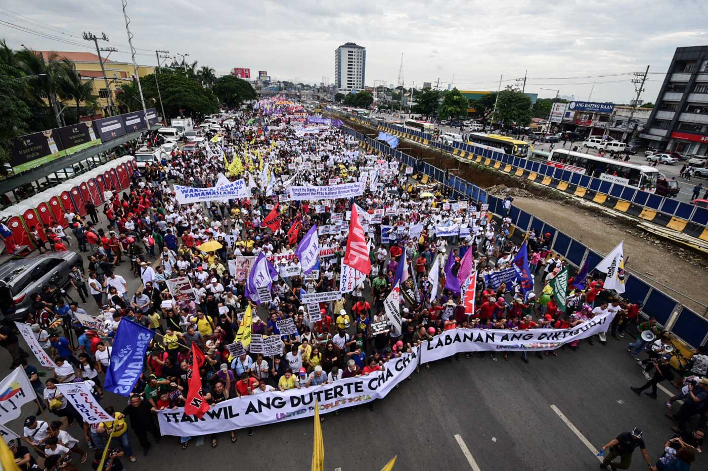 UNITED PEOPLE'S SONA. Protesters march towards Batasan along Commonwealth Ave., Quezon City during President Duterteu00e2u0080u0099s 3rd State Of The Nation Address. Photo by Alecs Ongcal/Rappler