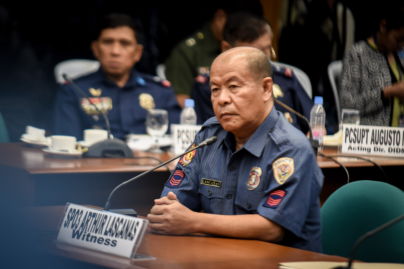I PROMISED GOD I WILL MAKE A PUBLIC CONFESSION. In this file photo taken at a Senate hearing in October 2016, then SPO3 Arturo Lascau00f1as denies the existence of the Davao Death Squad.
