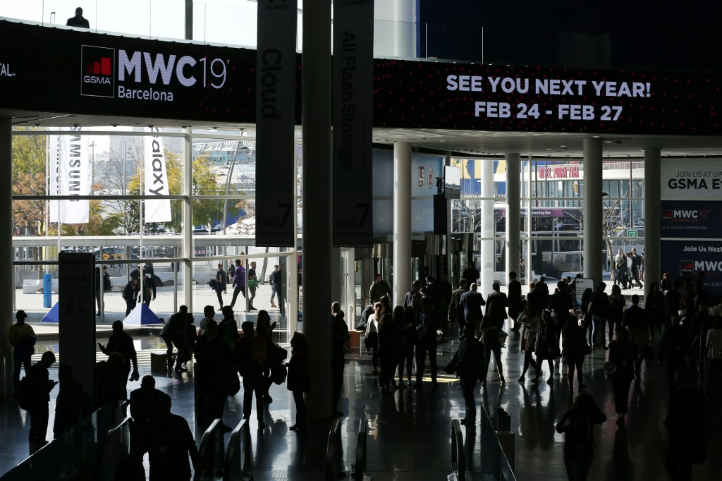 CANCELED. Visitors leave the Mobile World Congress (MWC) venue in Barcelona on February 28, 2019, the last day of the fair. File photo by Pau Barrena/AFP