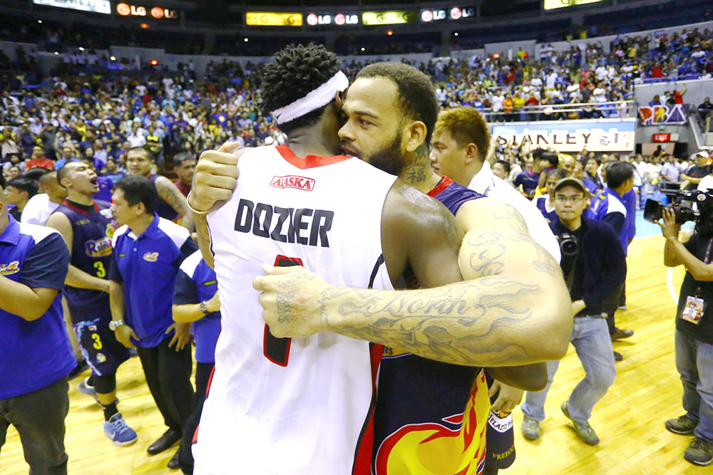 HUG. Alaska import Rob Dozier and Rain or Shine import Pierre Henderson-Niles hug it out after the hard-fought game. Photo by Josh Albelda/Rappler