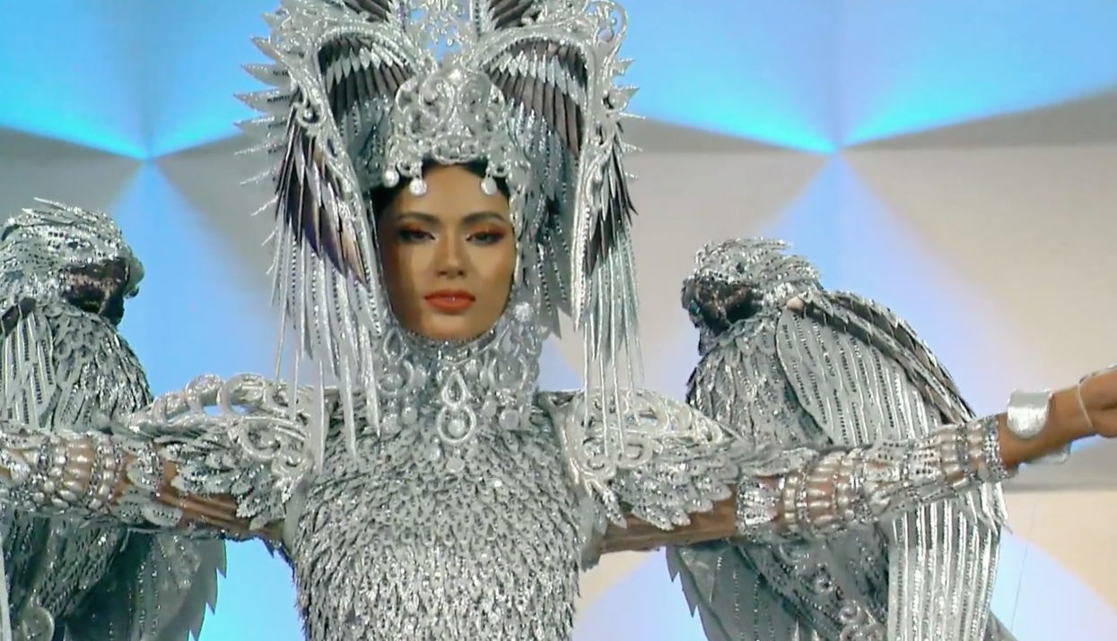 NATIONAL COSTUME. Gazini Ganados shows her silver national costume inspired by the Philippine eagle by Cary Santiago. Screenshot from Miss Universe