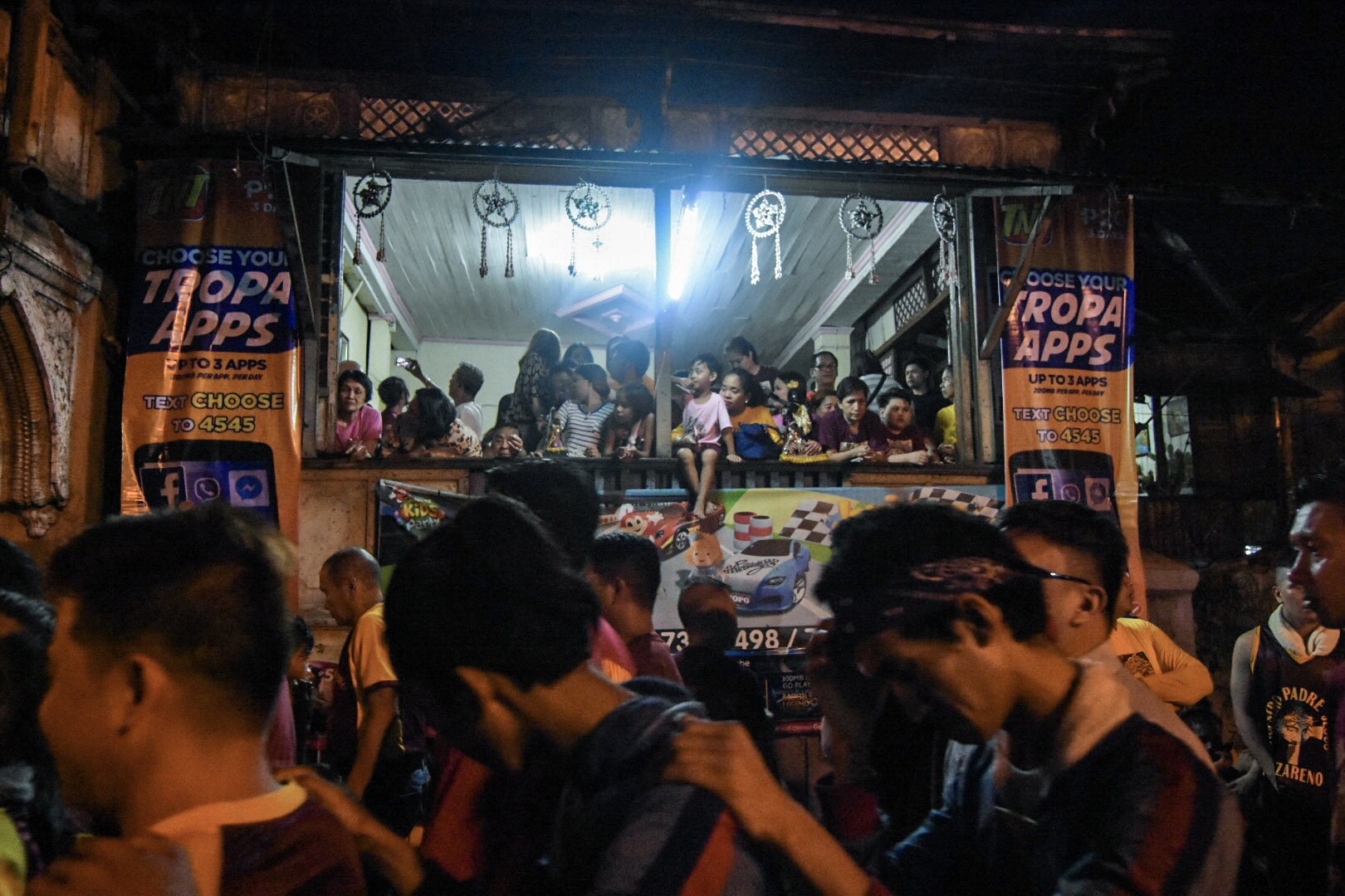 DEVOTEES. Some residents stay in their homes to keep safe from the swelling crowd.