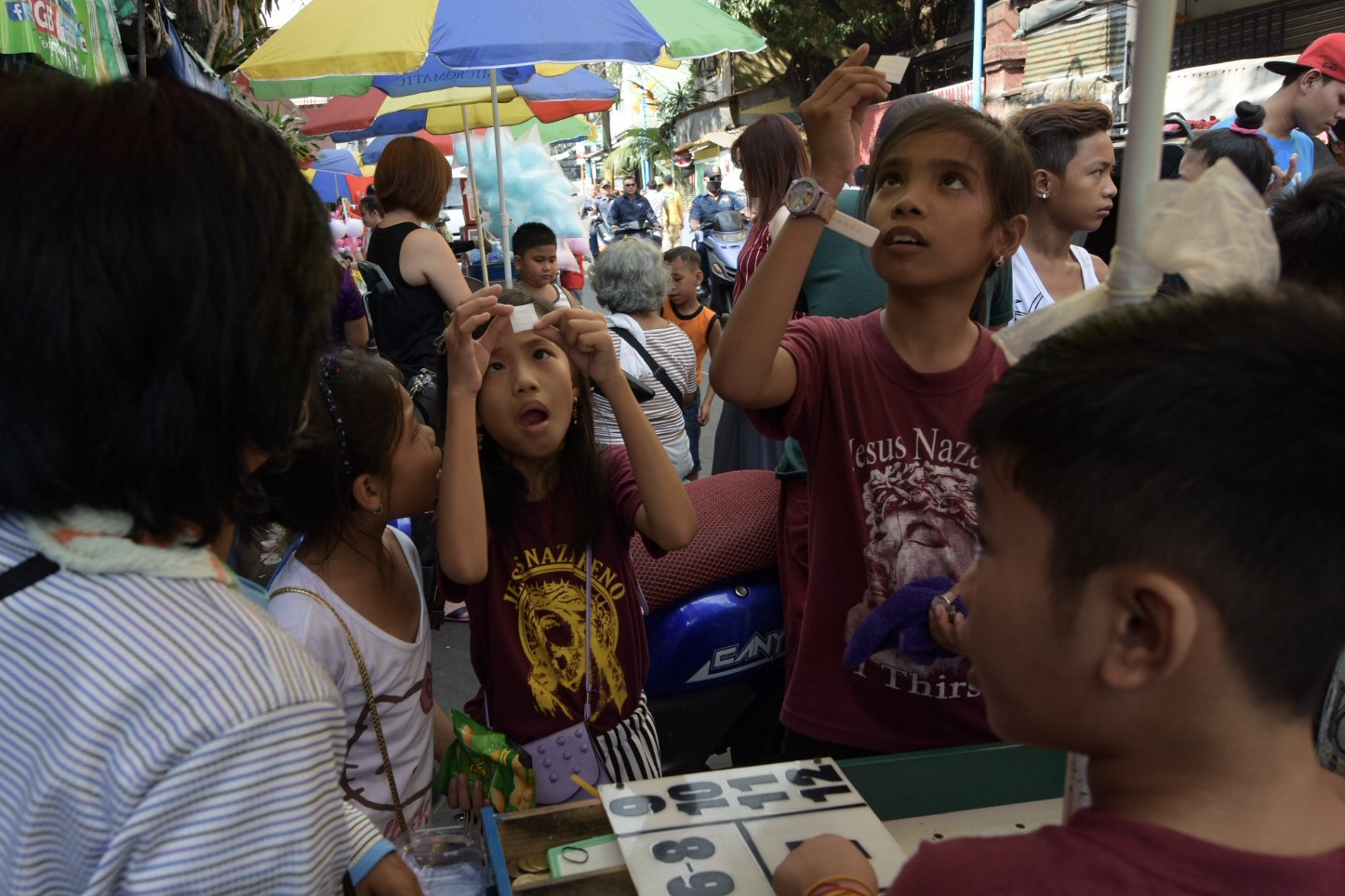 Kids try their luck to bring home a pet for a peso.