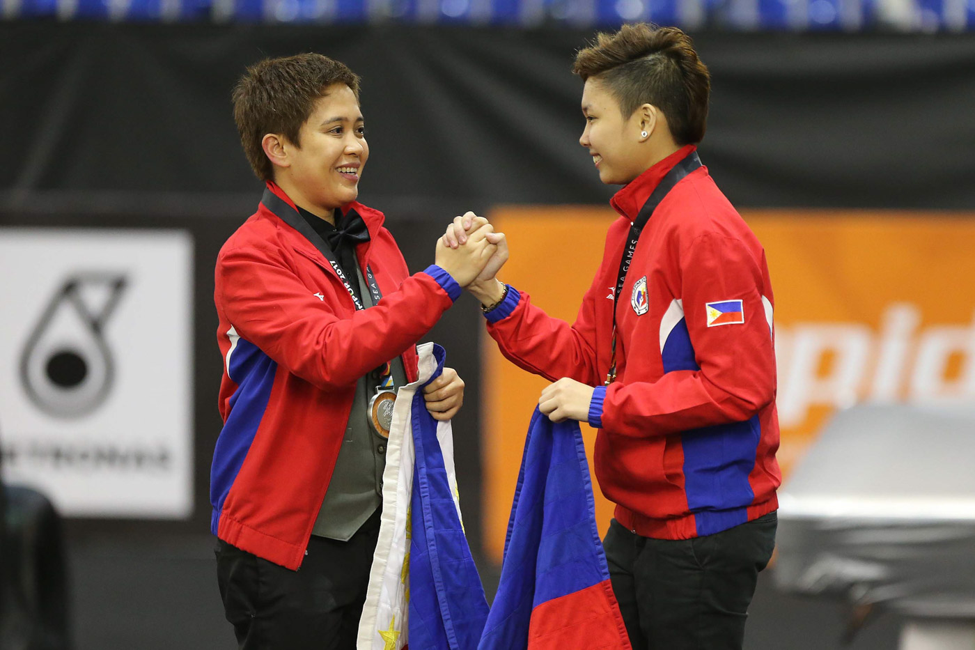 1-2 FINISH. Cheska Centeno (R) and Rubilen Amit of the Philippines celebrate after winning gold and silver medals, respectively, in the women's 9-ball singles event. This is the second straight SEA Games that Centeno and Amit faced in the final and won the gold and silver. Photo from PSC-POC Media