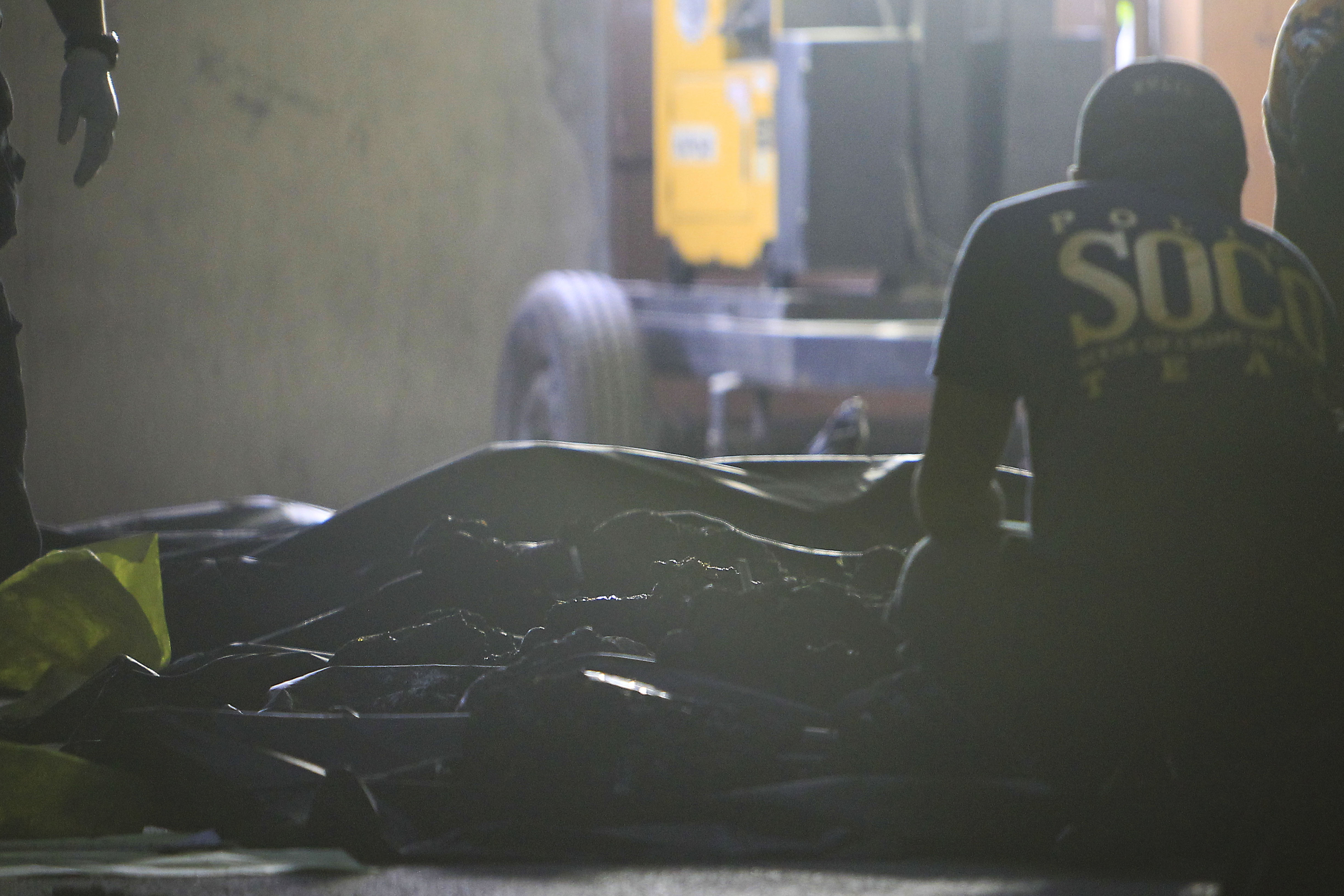 CASUALTIES. Authorities examine charred bodies of workers killed in the Kentex factory fire in Valenzuela City on May 14, 2015. Photo by Ben Nabong/Rappler