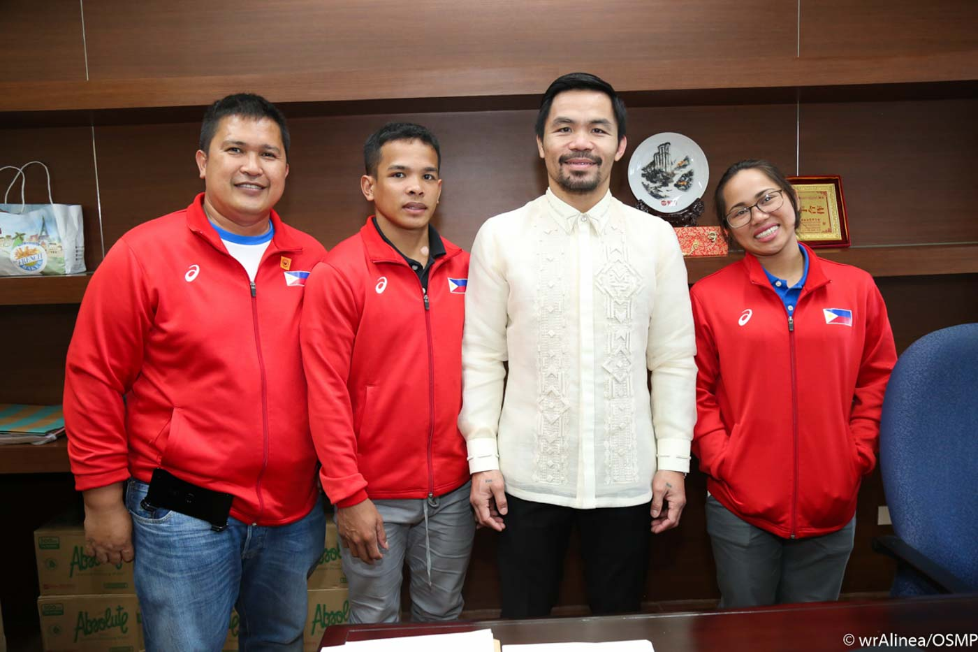 From left to right: Diaz's coach, Nestor Colonia, Manny Pacquiao, and Hidilyn Diaz. Photo by Wendell Alinea