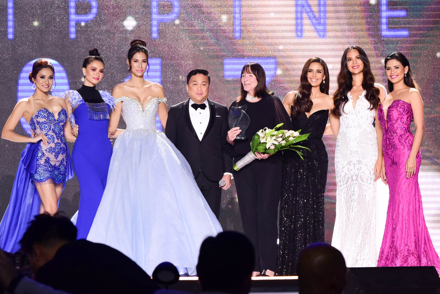 Julia Morley, Arnold Vegafria, and the Miss World Philippines past title holders.