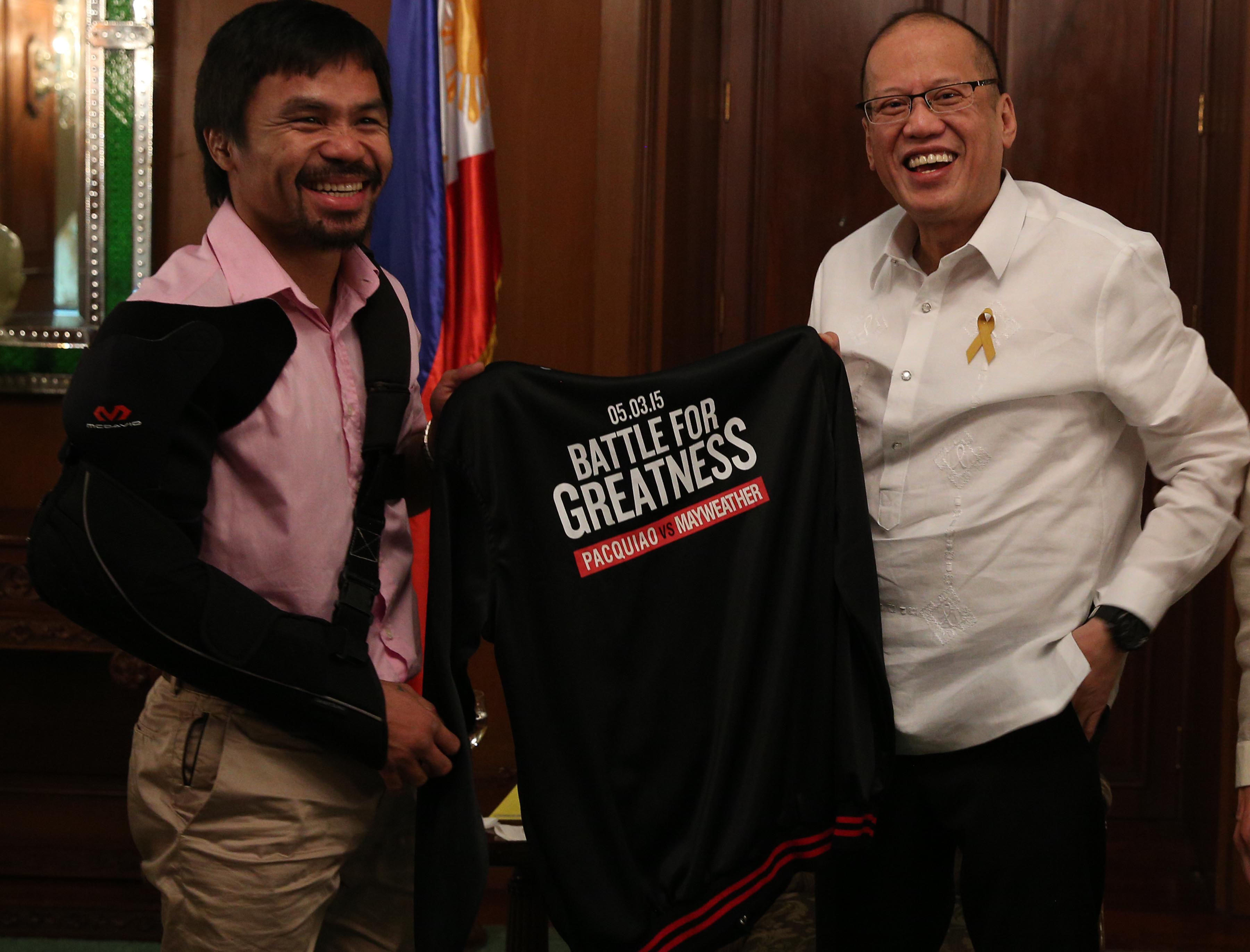 President Benigno S. Aquino III receives a black jacket from boxer Manny Pacquiao during the courtesy call at the Music Room of the Malacau00f1an Palace on Wednesday. Ryan Lim/ Malacau00f1ang Photo Bureau