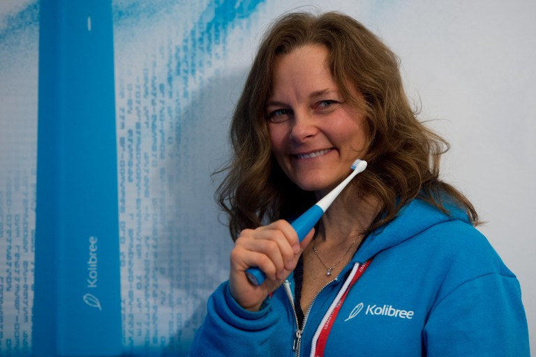 CONNECTED EVERYTHING. A hostess poses with a toothbrush u0022arau0022 by Kolibree's company during the Mobile World Congress on the last day of the MWC in Barcelona, on March 2, 2017. Photo by Josep Lago/AFP
