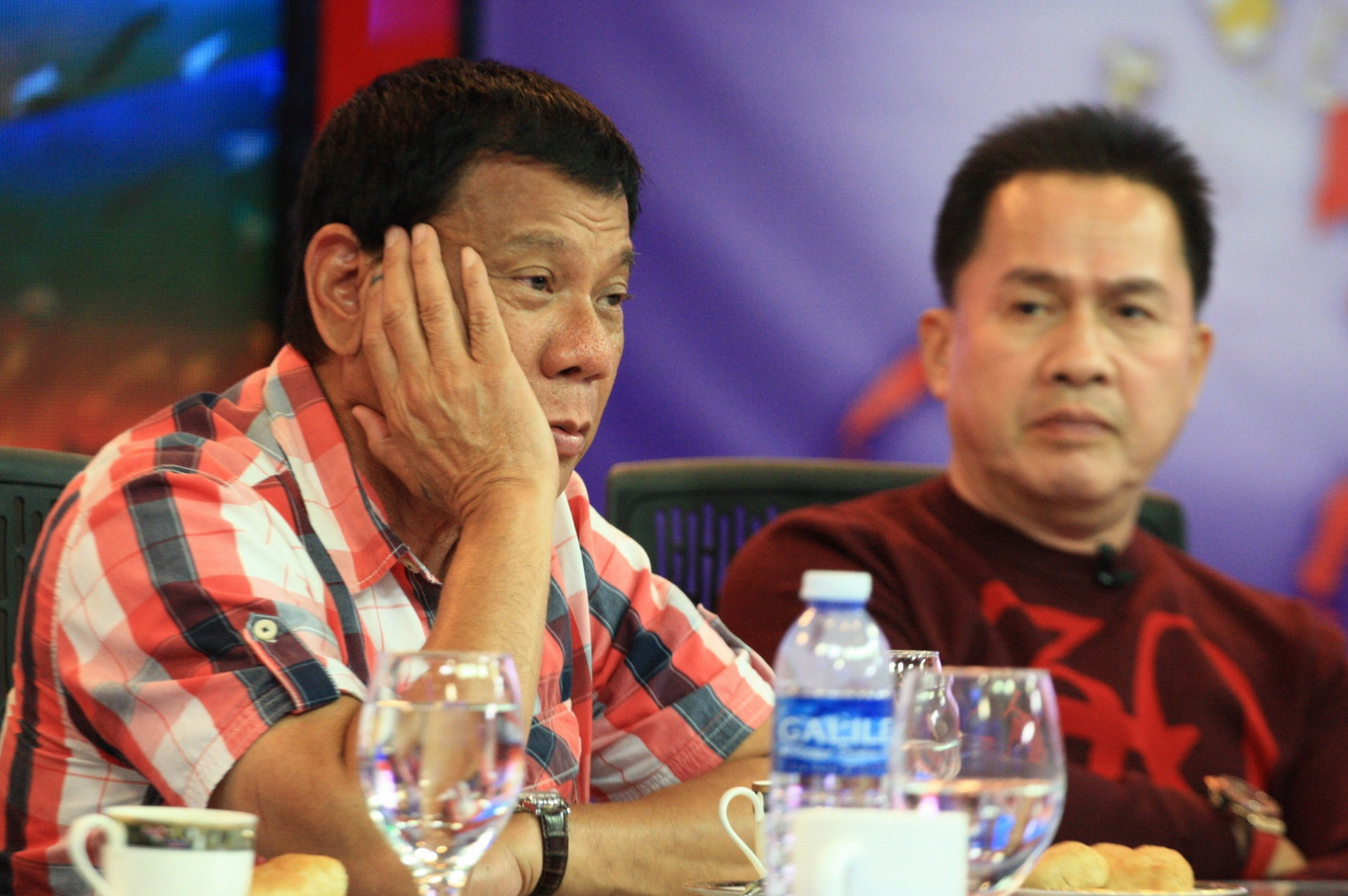SPAT BREWING? Duterte appears in Pastor Apollo Quiboloy's television show on Election Day, May 9, 2016. Photo by Manman Dejeto/Rappler