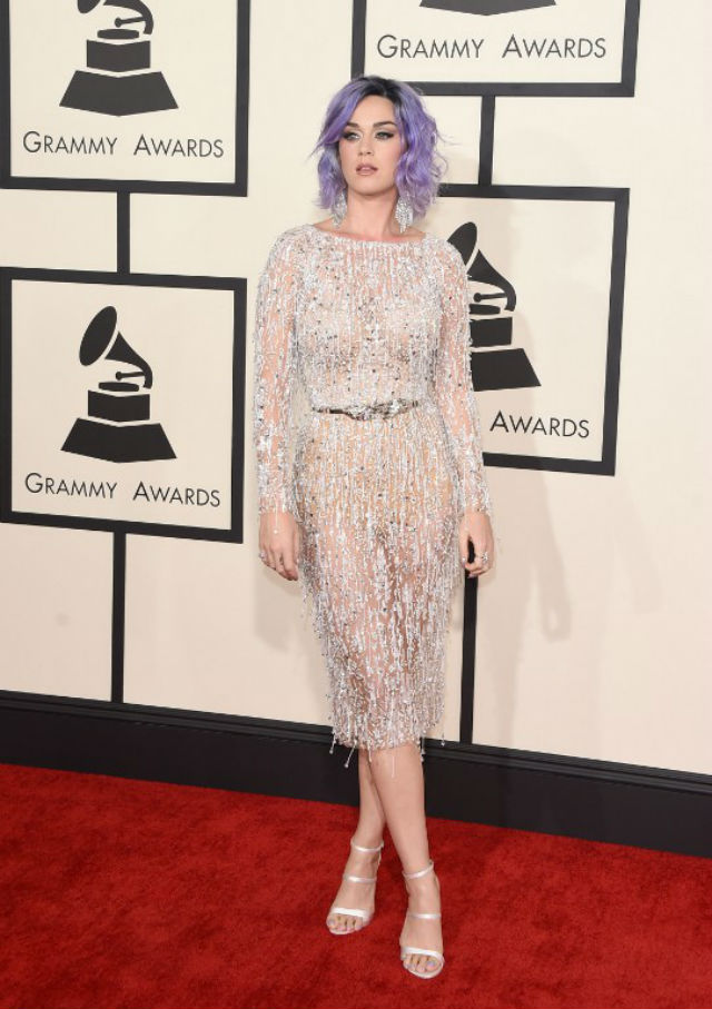 THAT PURPLE HAIR. She stuns in this white piece. Photo by Jason Merritt/Getty Images/AFP