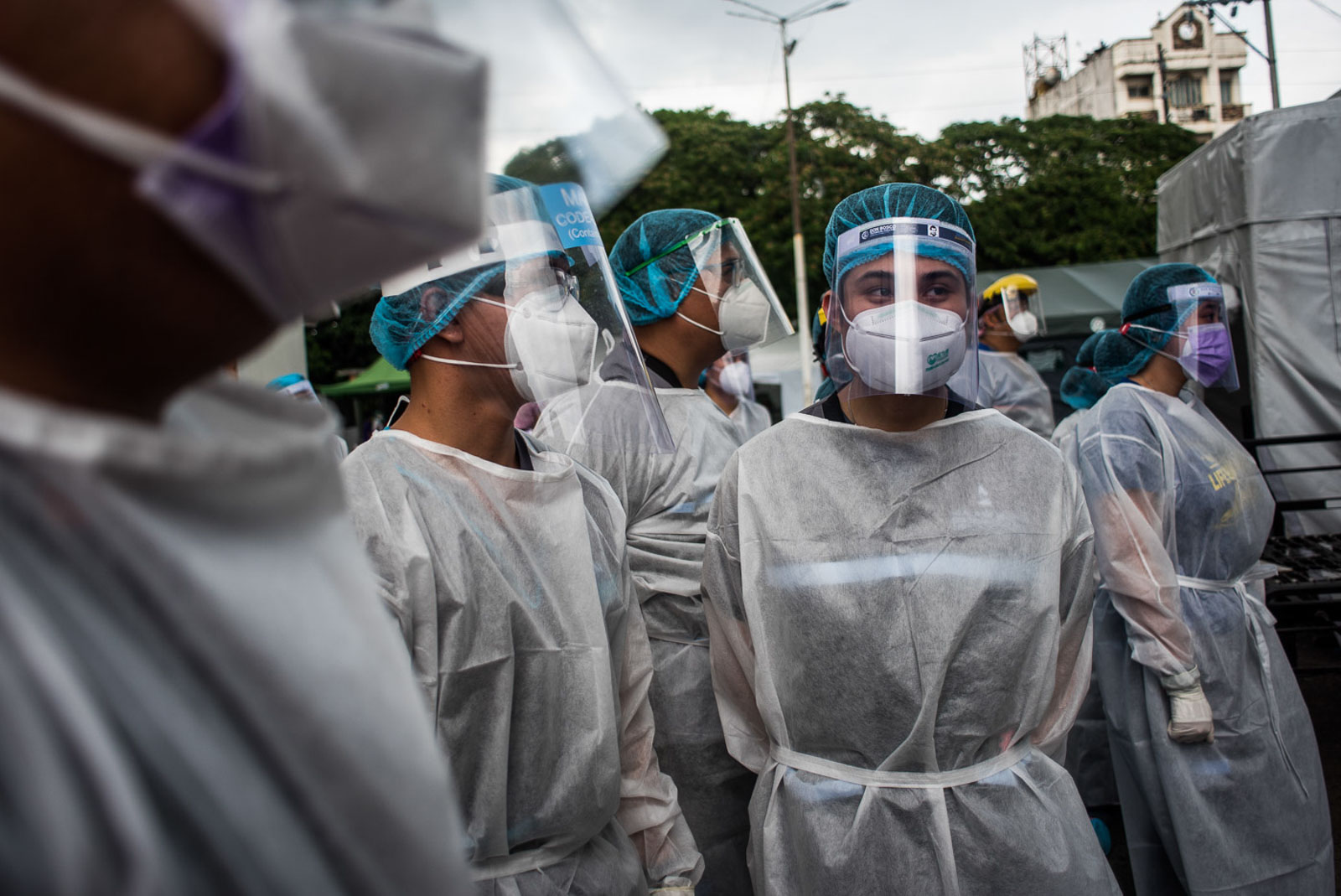 HIGH RISK. Health workers gather before starting to test suspected COVID-19 patients in Sta Ana Hospital in Manila on April 17, 2020. Photo by Lisa Marie David/Rappler