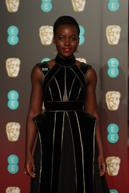 SUPPORT. Lupita Nyong'o poses on the red carpet upon arrival at the BAFTA Photo by Daniel Leal-Olivas/AFP