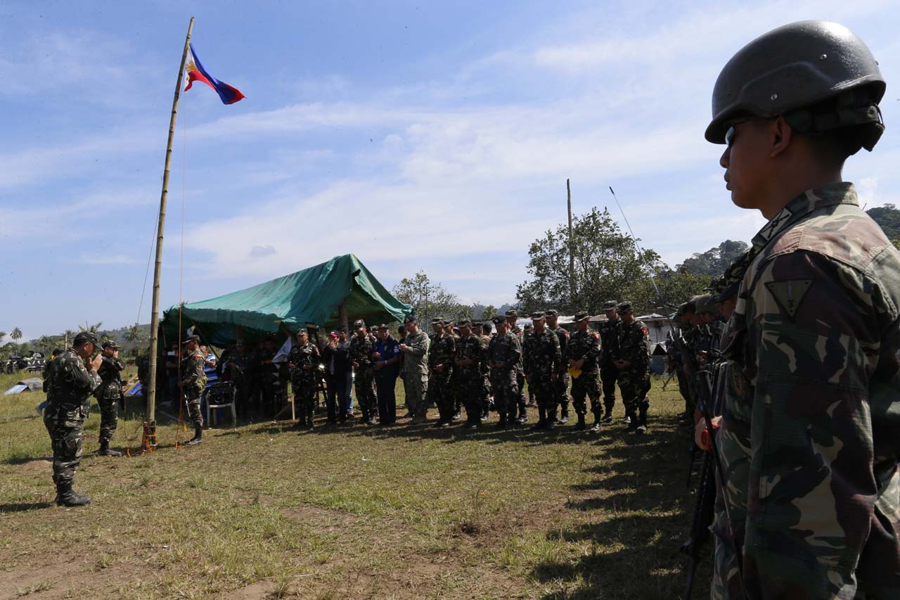 ALL CLEAR? Troops attend a flag-raising ceremony in Butig, Lanao del Sur, Tuesday, March 1, 2016. Photo by Rappler