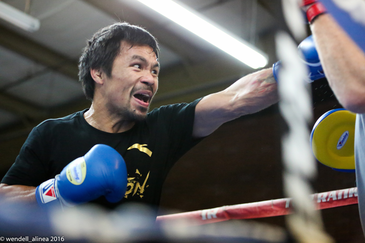 HEAVY HITTER. Manny Pacquiao looked focused on landing with heavier power in his final gym workout before facing WBO welterweight champ Jessie Vargas. Photo by Wendell Alinea/Rappler