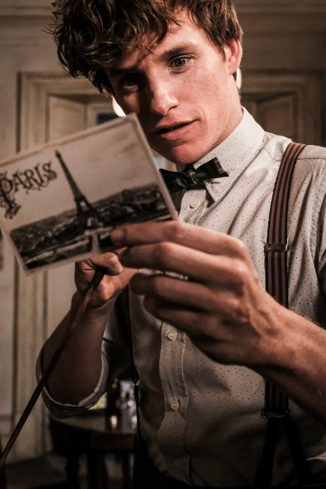 NEW ADVENTURE. Newt Scamander holds an intriguing postcard from Paris. Photo from Facebook.com/pottermore