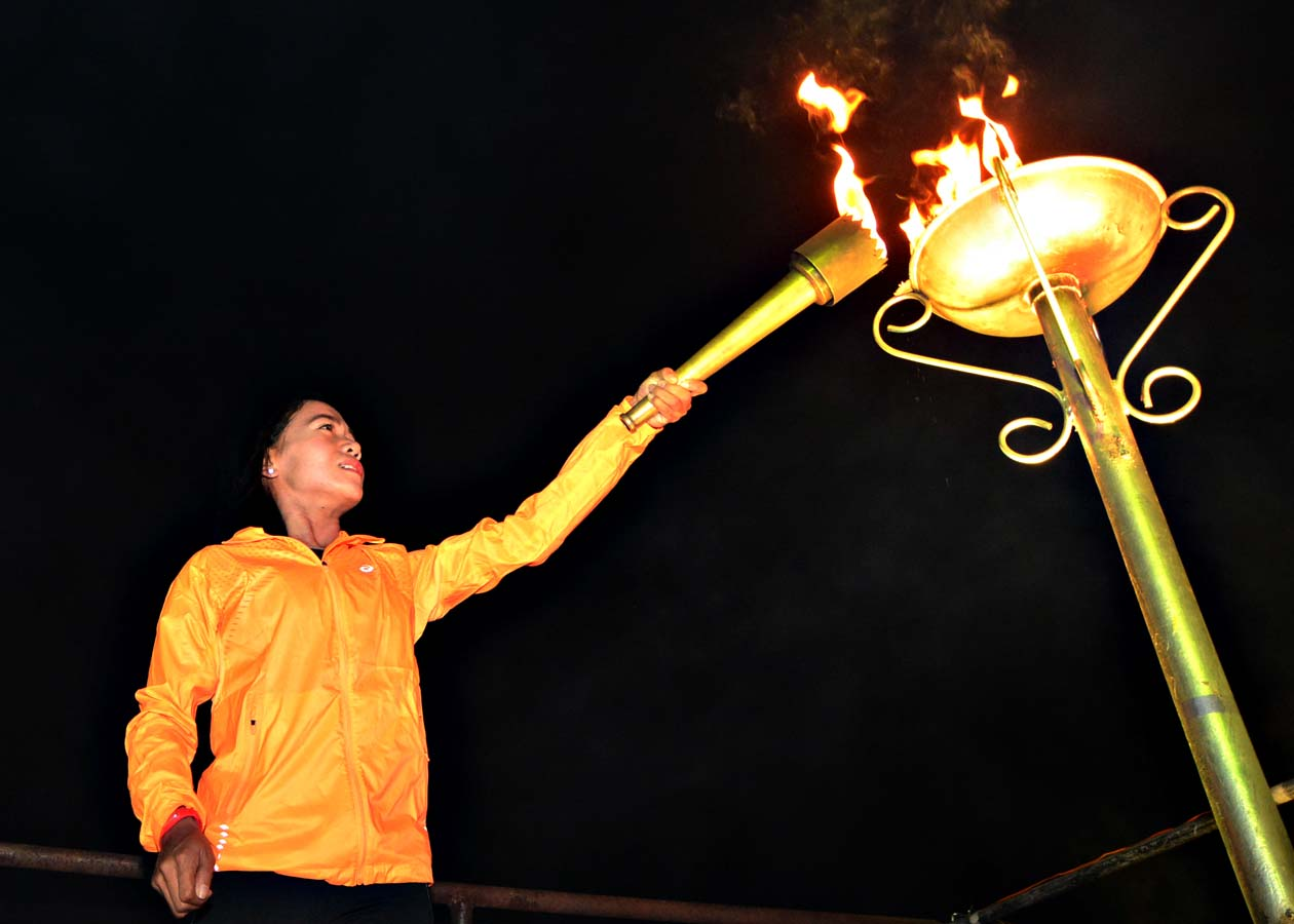 Mary Joy Tabal lights the flame at the 2015 Batang Pinoy National Finals held in Cebu City. Photo by Nathan Soriano