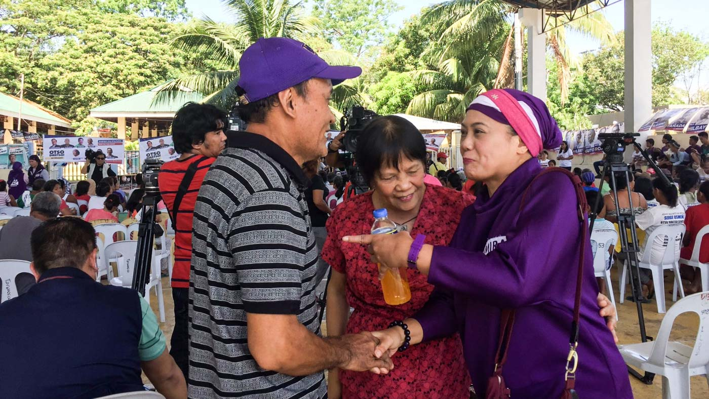NOT AFRAID. Marawi Civic leader Samira Gutoc with Barangay Taloot Councilor Evangeline Rellin and her husband, Rolando Rellin, the President of Senior Citizens of Argao. Photo by Micole Gerard Tizon/Rappler