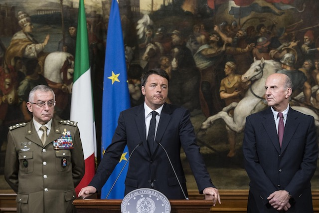 Italian Prime Minister Matteo Renzi (C) speaks next to Defense General Staff Danilo Errico (L) and Head of Police Alessandro Pansa (R), during a press conference about a capsized migrant ship off Italian coast, at Chigi Palace in Rome, Italy, 19 April 2015. Angelo Carconi/EPA