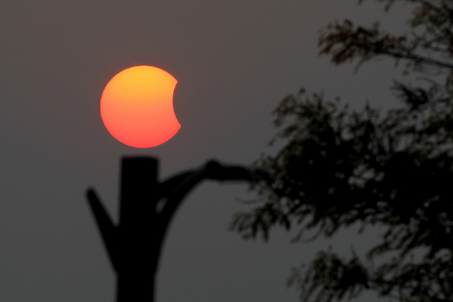 GOLDEN SUNRISE. A partial solar eclipse is seen in Naypyitaw, Myanmar, March 9, 2016. Hein Htet/EPA