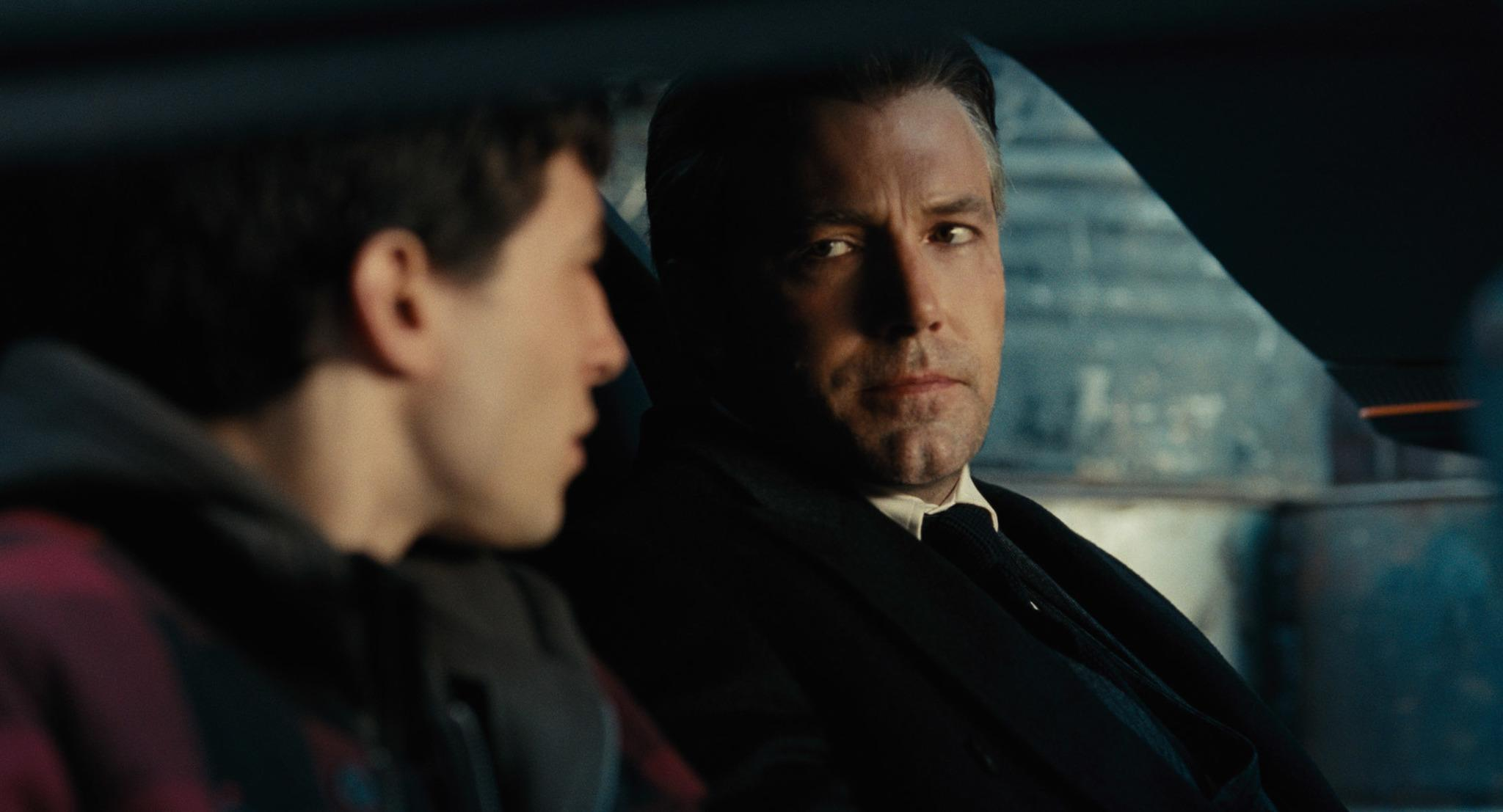 Bruce Wayne (Ben Affleck) talks to The Flash about helping them save the world