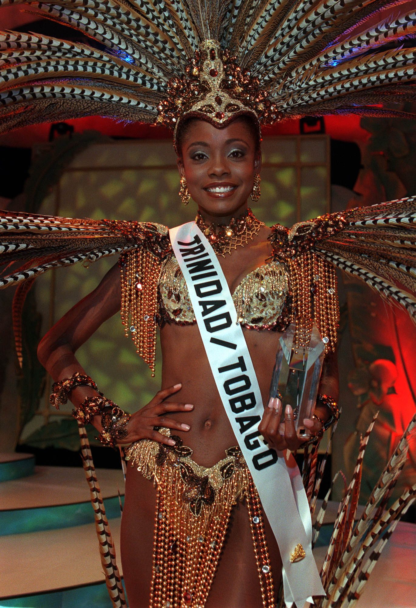 Wendy Fitzwilliam, MISS TRINIDAD u0026 TOBAGO 1998, wins Best in National Costume Award May 7, 1998 from Honolulu, Hawaii chosen by a panel of Hawaiian based judges. Fitzwilliam said the costume, entitled u0022Freedomu0022 , represents the spirit of her people and a cry of hope. The prize includes $1,000 cash and commemorative Hoya Crystal Trophy.  Photo from the Miss Universe Organization