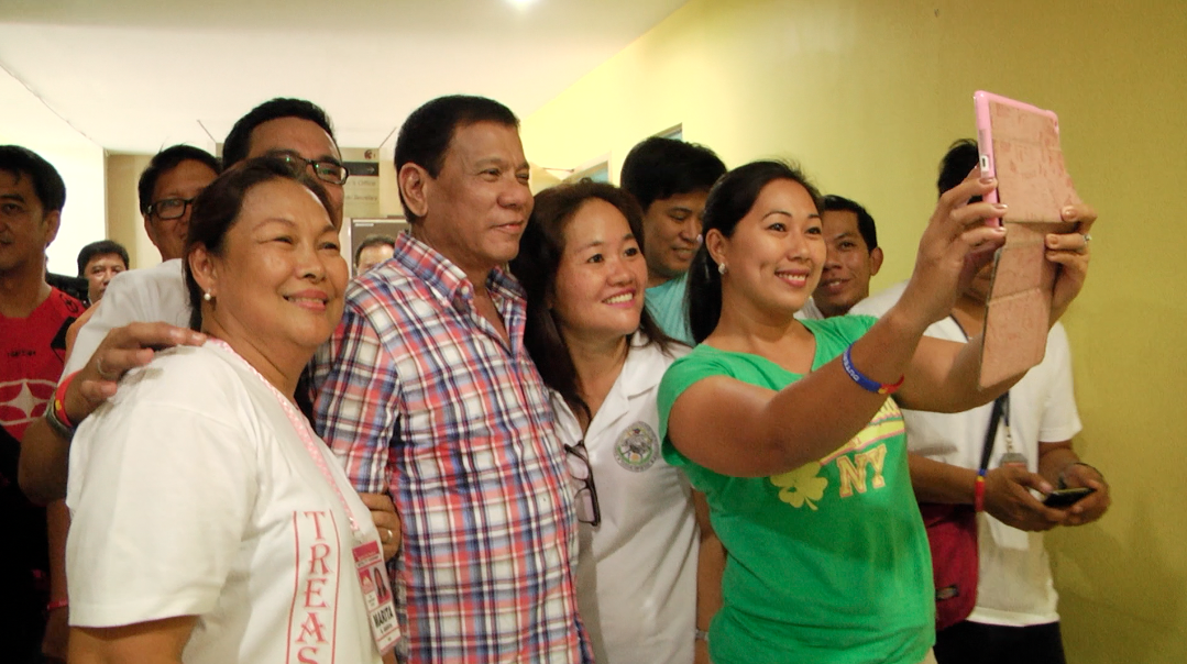 FANGIRLS. Duterte poses with residents of Navotas during a September visit to Metro Manila. Photo by Naoki Mengua/Rappler