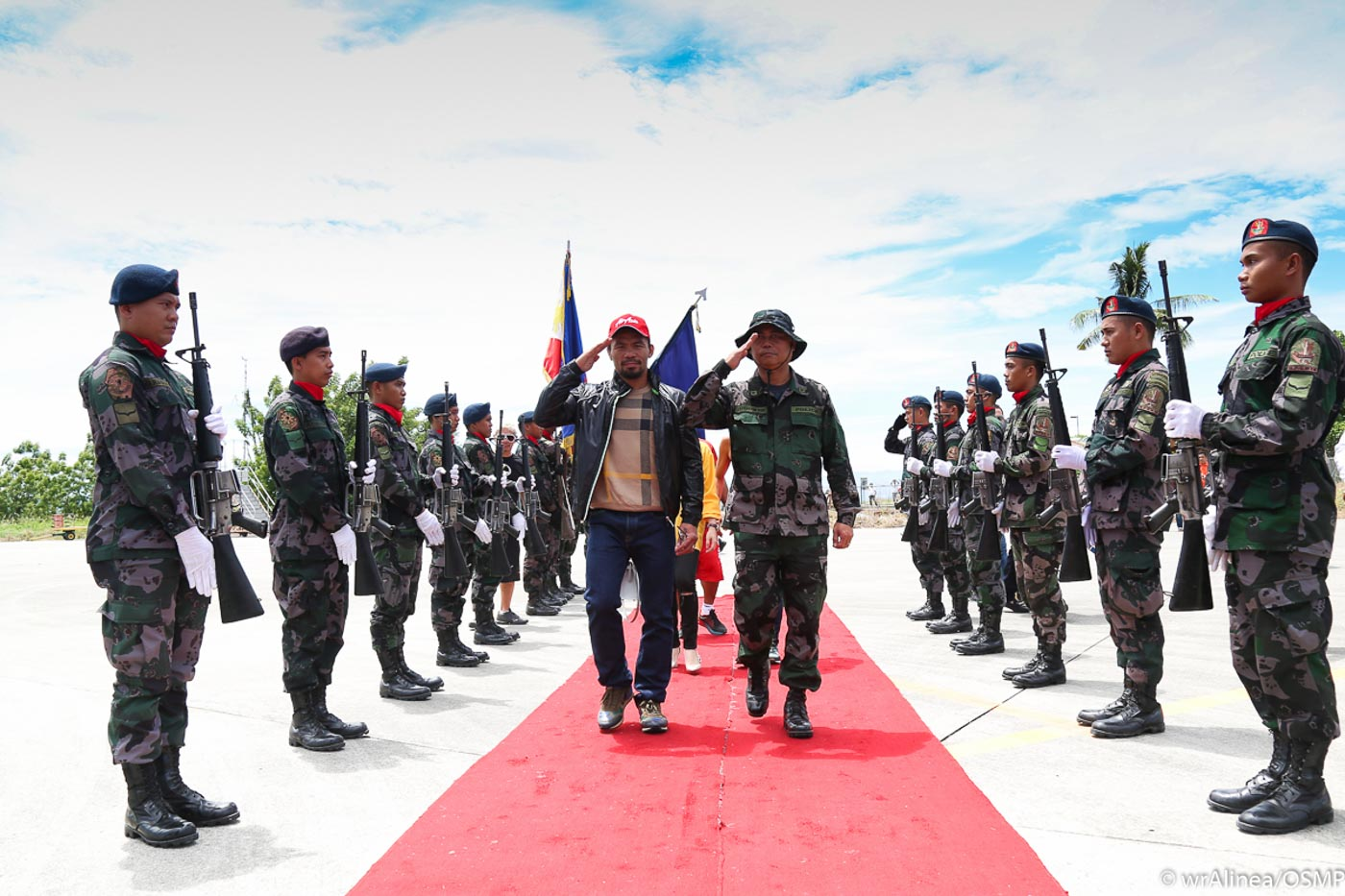 Manny Pacquiao walks to his airplane with a military escort. Photo by Wendell Alinea