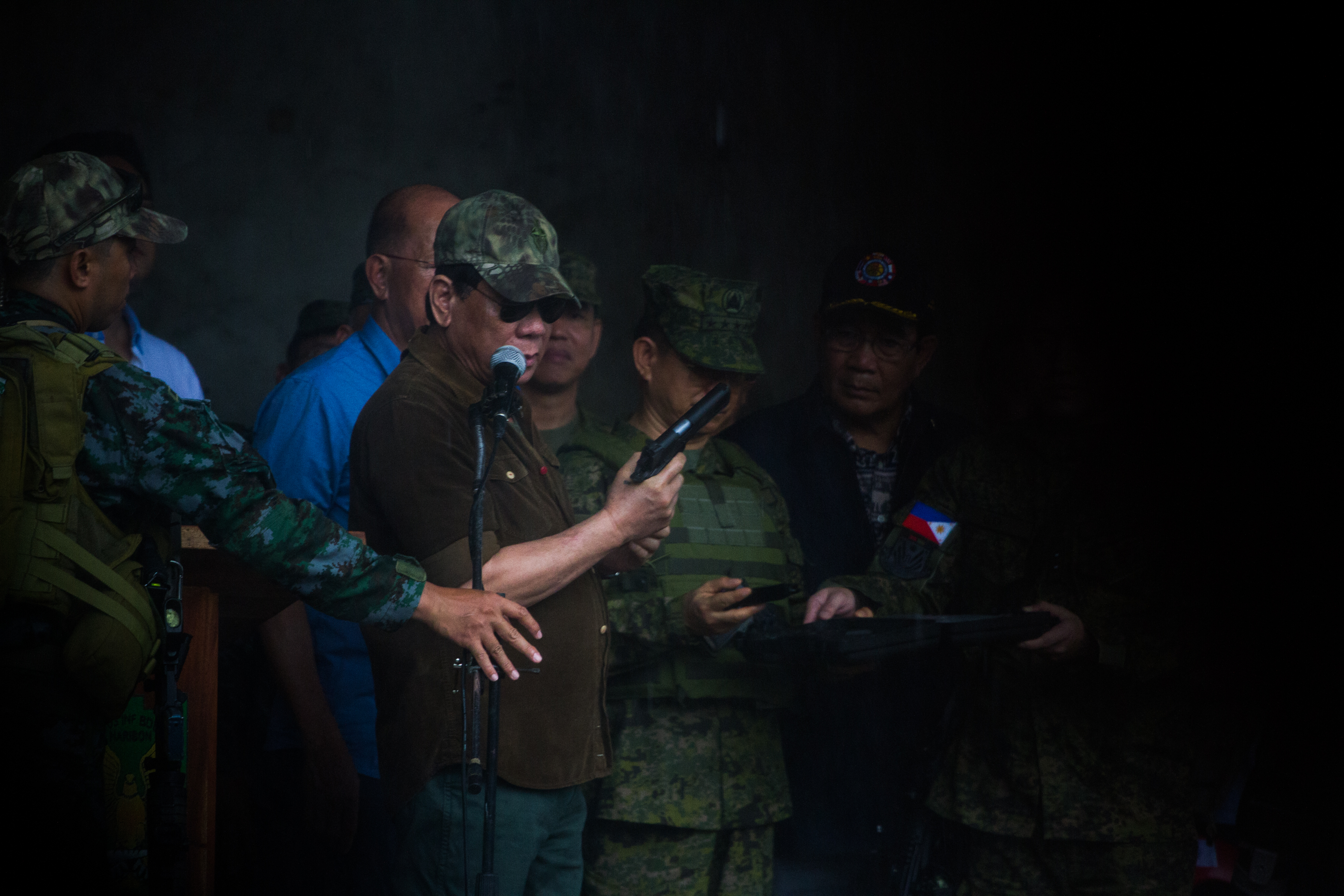 PISTOL. President Rodrigo Duterte shows a pistol he's going to give to the soldiers.