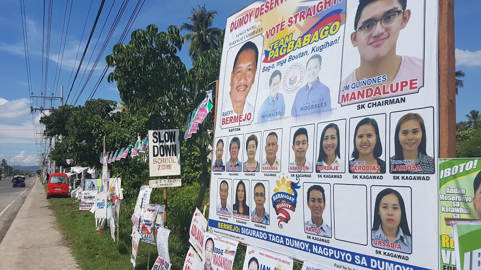 TEAM NOGRALES? Poll candidates in Barangay Dumoy are shown in one huge poster with pictures of Davao City 1st District Representative Karlo Nograles and PBA Partylist Representative Jericho Nograles. Photo by Mick Basa/Rappler
