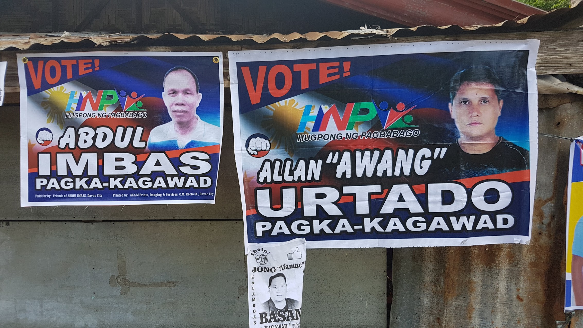 TEAM HNP? Posters of Bago Aplaya candidates Abdul Imbas and Allan 'Awang' Urtado show the logo of Hugpong ng Pagbabago. Photo by Mick Basa/Rappler