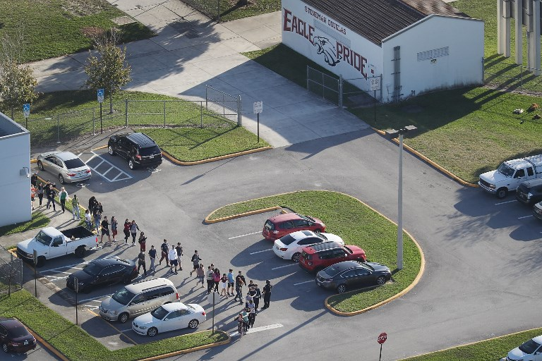 GUN CONTROL. In this file photo, people are brought out of the Marjory Stoneman Douglas High School after a shooting at the school that reportedly killed and injured multiple people on February 14, 2018 in Parkland, Florida. File photo by Joe Raedle/Getty Images/AFP