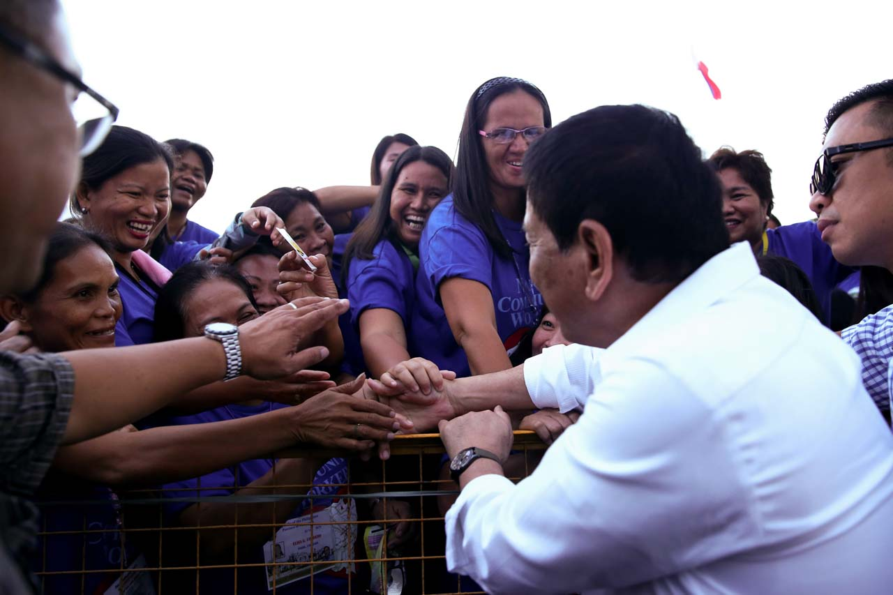 FEMALE FANS. Women take turns shaking President Duterte's hands during a Nanay Volunteers event in December 2016. Photo by Karl Norman Alonzo/Presidential Photo