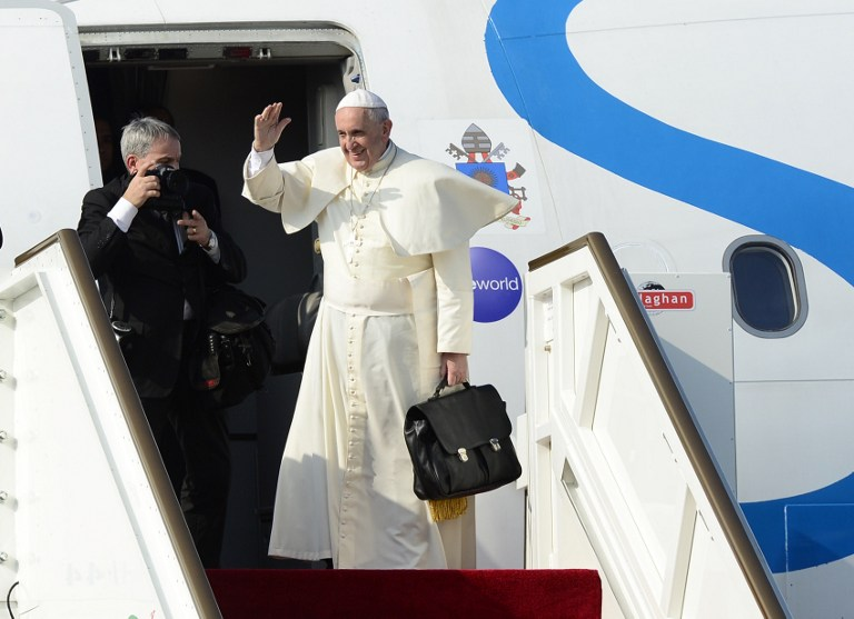 In this file photo, Pope Francis waves goodbye during a departure ceremony at Bandaranaike International Airport in Katunayake, near Colombo, on January 15, 2015. Lakruwan Wanniarachch/AFP