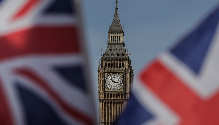 SEAT OF POWER. Union flags fly near the Houses of Parliament, comprising the House of Commons and the House of Lords, in London on March 13, 2017. Daniel Leal-Olivas/AFP