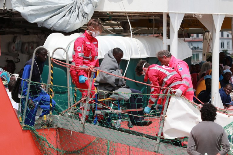 RESCUED. Members of the Italian Red Cross help a migrant to disembark from the Aquarius rescue Ship run by NGO S.O.S. Mediterranee and Medecins Sans Frontieres in the port of Salerno after a rescue operation in the Mediterranean sea, on May 26 2017. Carlo Hermann/AFP